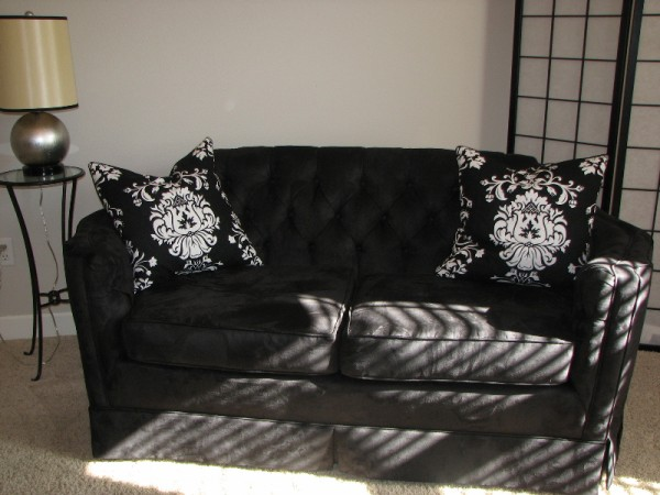 Re-Upholstered Black Loveseat